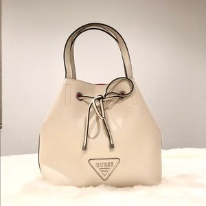 Guess Bags - Guess purse with shoulder strap.